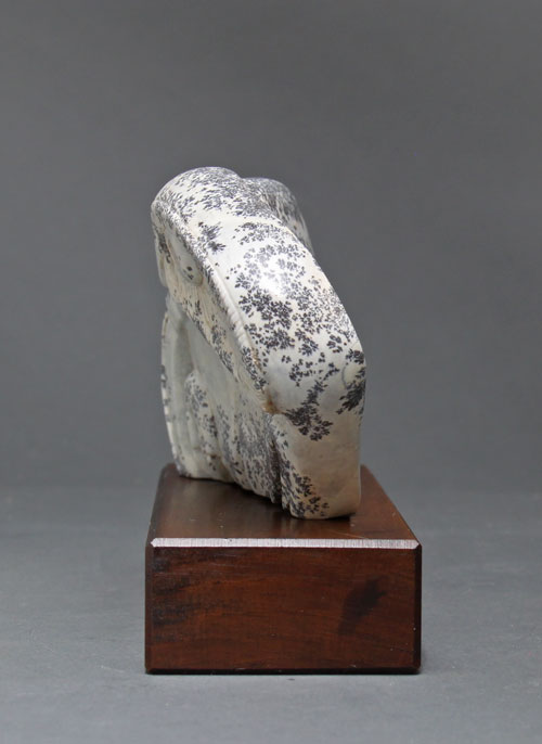 A side view of dendritic Soapstone Owl #20 by Clarence P. Cameron of Madison, Wisconsin