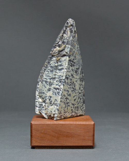 A side view of the dendritic Soapstone Owl #24 by Clarence P. Cameron of Madison, Wisconsin