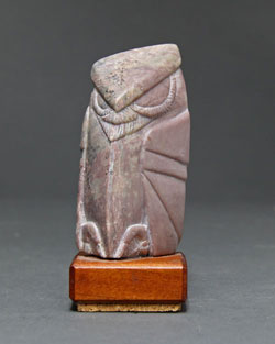 Soapstone Owl #8 - A carving in dendritic soapstone by Clarence P. Cameron of Madison, Wisconsin. It is the most rare of colors of dendritic soapstone. It is mauve.