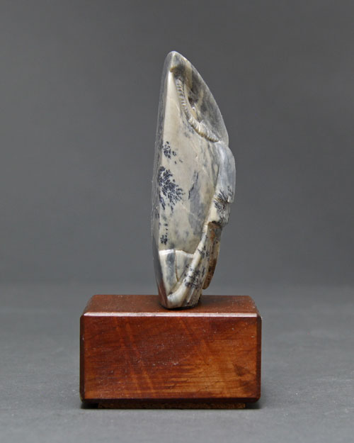 A photo of the other side of dendritic Soapstone Owl #17 by Clarence P. Cameron of Madison, Wisconsin