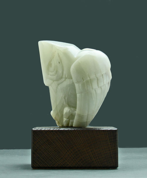 A side view of Soapstone Owl #3 by Clarence P. Cameron of Madison, WI