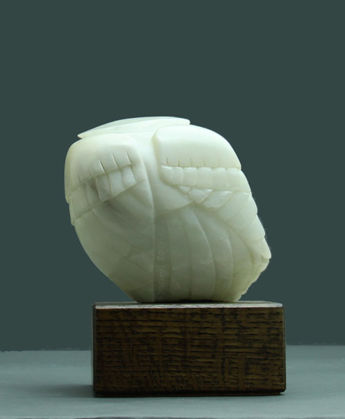 A view of the back of Soapstone Owl #3 by Clarence P. Cameron of Madison, WI