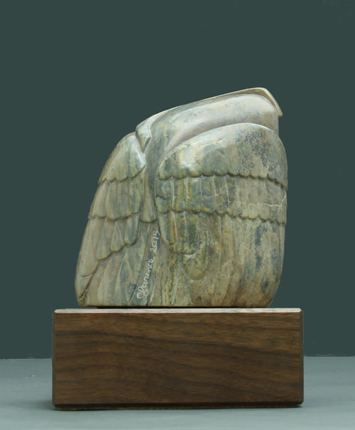 A photo of the back of Soapstone Owl #21