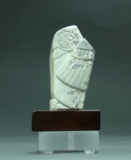 A frontal view of  Soapstone Owl #5 by Clarence P. Cameron