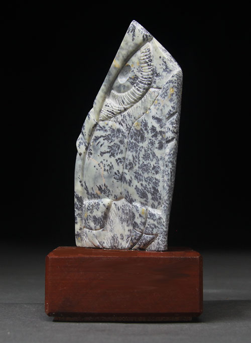 A side view of dendritic Soapstone Owl #21 by Clarence P. Cameron of Madison, Wisconsin