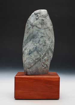Soapstone Owl #21L, another fine example of the variation in dendritic soapstone. It is mounted on a cherry base.
