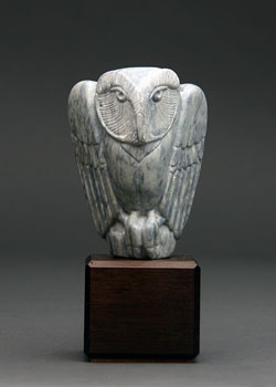 A photo of Soapstone Owl #17F, a fine example of dendritic soapstone. This is Soapstone Owl #17F by Clarence P. Cameron